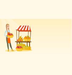 Greengrocer holding box full of apples vector