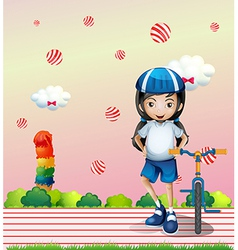 A girl and her bicycle vector image