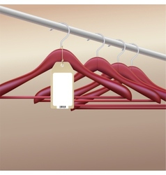 Wooden hangers with blank tag vector