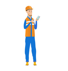 young caucasian builder holding a mobile phone vector image