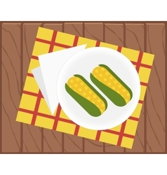Boiled corn on a plate vector
