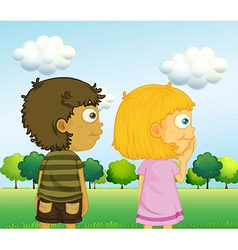 A boy and a girl in front of the trees vector image vector image