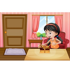 A girl opening her gift inside the house vector image