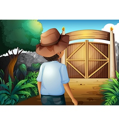 A man with a hat inside the gated yard vector