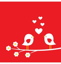Two cute birds on blooming branch vector image