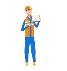 Young caucasian builder holding tablet computer vector