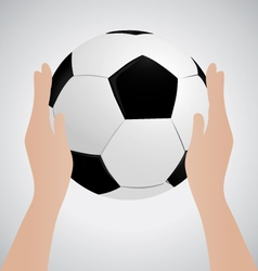 Hand holding soccer ball up sport concept vector