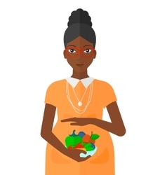 Pregnant woman with vegetables vector image