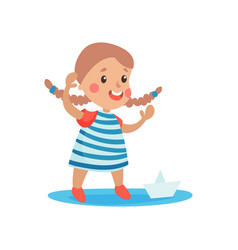 cute little girl in sailors costume playing with vector image