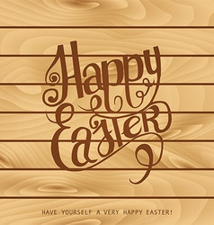 Inscription happy easter on the wooden background vector