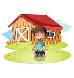 A boy holding an egg tray vector image vector image