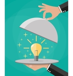 Hands holding platter cloche with idea light bulb vector image vector image