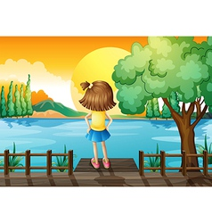 A girl standing facing at the river vector