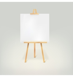 Wooden tripod with a white sheet of paper vector