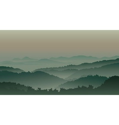 Green mountains in fog vector