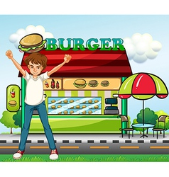 A man in front of the burger stand vector