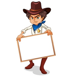 A cowboy holding an empty frame vector image vector image