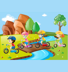 Children riding bicycle over the bridge vector