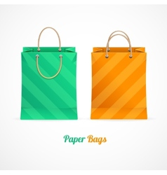 Green and orange paper shopping bags vector