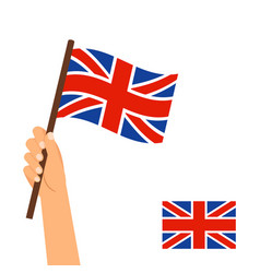 Hand holding flag of britain vector