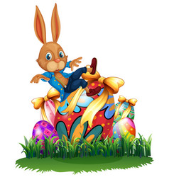 Cute bunny and easter eggs in garden vector
