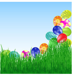 Easter eggs roll into the grass vector