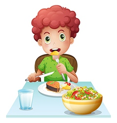 A boy eating vector image vector image