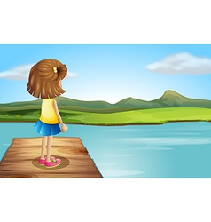 A little girl standing at the wooden port vector