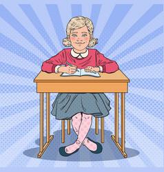 Pop art schoolgirl sitting at school desk vector