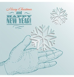 Snowflake on a palm- christmas background vector