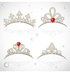 Set openwork jewelry tiaras with diamonds and vector