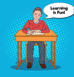 Pop art happy schoolboy doing homework vector