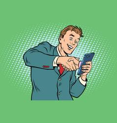 Business handshake via smartphone vector