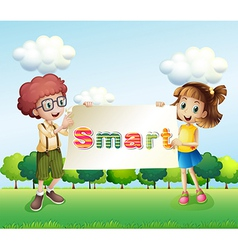 Smiling kids holding a signboard vector image