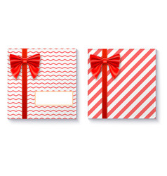 Gift boxes with big red bow and ribbon on white vector