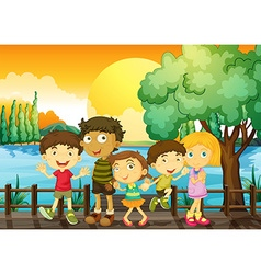 Children on the bridge at sunset vector image