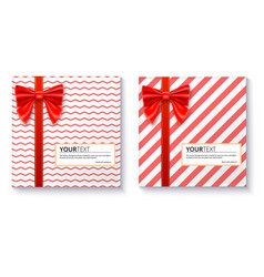 gift boxes with big red bow and ribbon on white vector image vector image