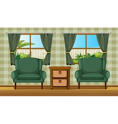 Cushion chairs and a side table vector
