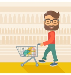 Male shopper pushing a shopping cart vector