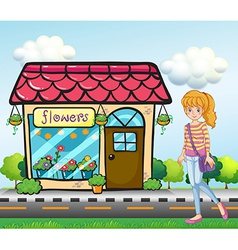 A girl with a bag outside the flower shop vector