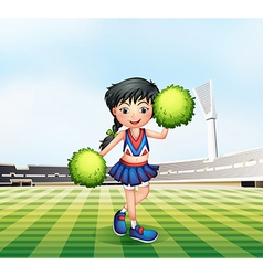 A cheerleader in the soccer field vector image vector image
