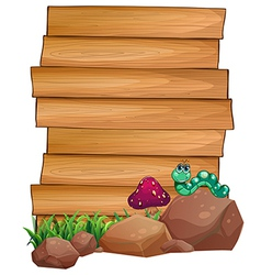 Empty wooden boards near the rocks with a worm vector image vector image