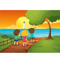 Three kids watching the lighthouse vector