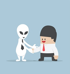 Businessman shaking hands with alien vector