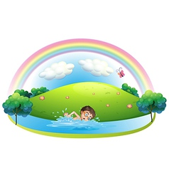 A boy swimming in the river near the hill vector image