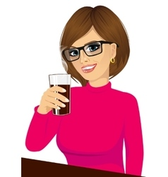 Young girl holding drink glass vector