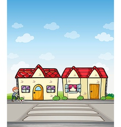 A boy with a dog and houses vector image