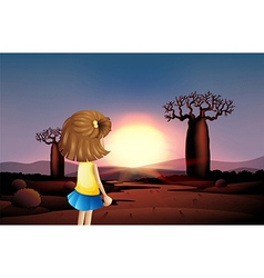 A young girl watching the sunset at the desert vector