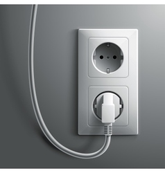 Electric white plug and socket on grey wall vector