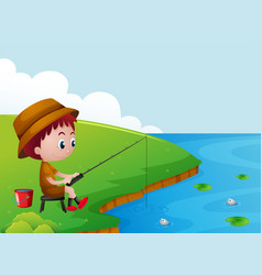 little boy fishing by the river bank vector image